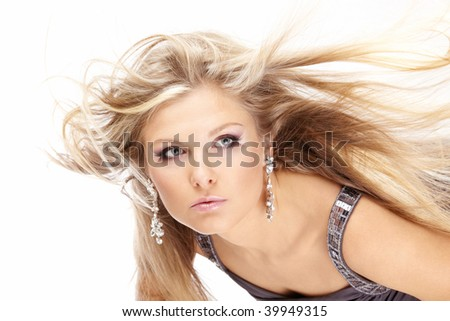 Portrait of beautiful blonde with the flying hair, isolated - stock photo
