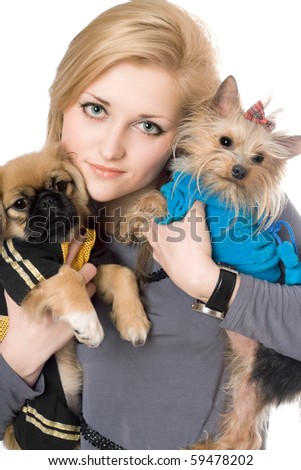 Portrait of beautiful blonde with two dogs. Isolated on white