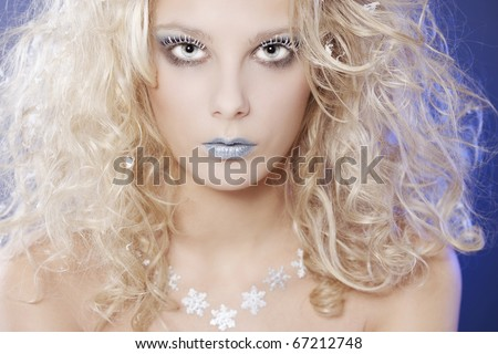 Portrait of beautiful blonde with winter make-up - stock photo