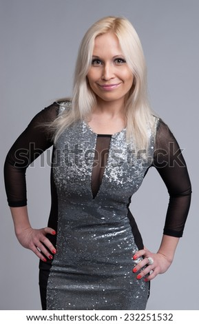 portrait of beautiful blonde woman over gray background