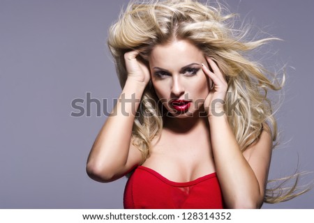 Portrait of beautiful blonde woman with red lips and curly hairs - stock photo