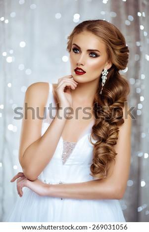 Portrait of Beautiful Bride in Lights. Fashion Dress and MakeUp. Beautiful White Bokeh - stock photo