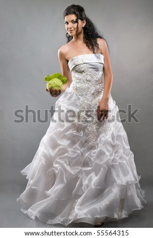 portrait of beautiful bride with bouquet studio shot - stock photo