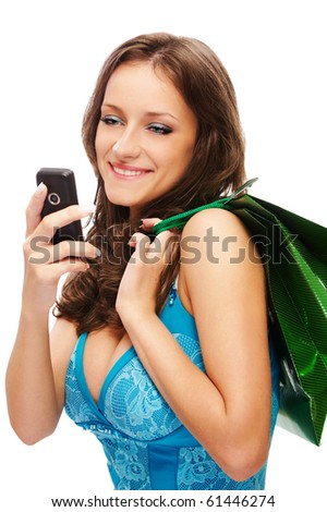 portrait of beautiful brown-haired girl withmobile and shopping bag - stock photo
