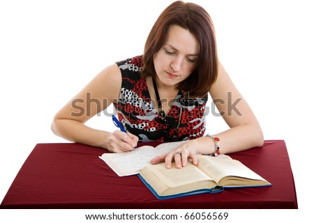 portrait of beautiful brown-haired girl writing in a notebook - stock photo