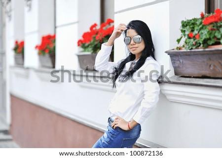 Portrait of beautiful brunette girl in sunglasses - stock photo