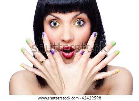 portrait of beautiful brunette girl shows her finger-nail make up - stock photo