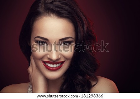 Portrait of beautiful brunette with beautiful hairstyle and a smile on his face - stock photo