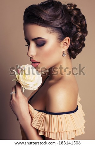 portrait of beautiful brunette with rose - stock photo