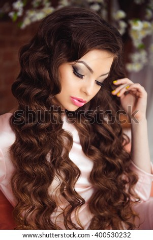 Portrait of Beautiful Brunette Woman with Perfect Make Up and Hairstyle. Vintage Toning