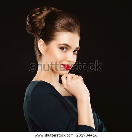 Portrait of Beautiful Brunette Woman with Perfect Makeup and Hairstyle. Close Up Isolated on Black Background - stock photo