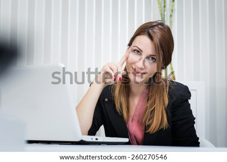 Portrait of beautiful business woman at office. Marketing manager. Internet developer.  - stock photo