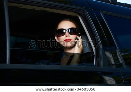 Portrait of beautiful business woman inside the limo car - stock photo