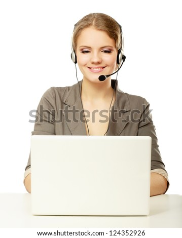 Portrait of beautiful business woman working at her desk with headset and laptop.