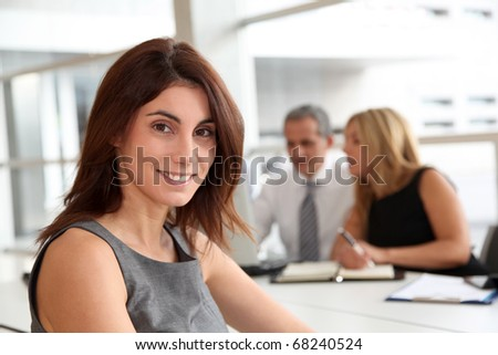 Portrait of beautiful businesswoman in work meeting - stock photo