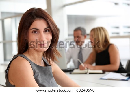 Portrait of beautiful businesswoman in work meeting - stock photo
