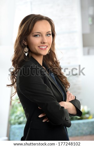 Portrait of beautiful businesswoman smiling inside office building