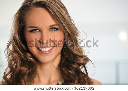 Portrait of beautiful businesswoman smiling inside office complex