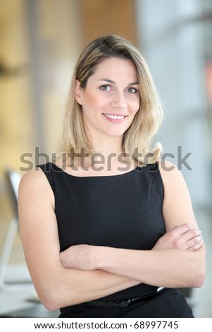 Portrait of beautiful businesswoman with arms crossed - stock photo