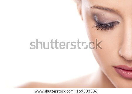 portrait of beautiful calm woman on white background - stock photo