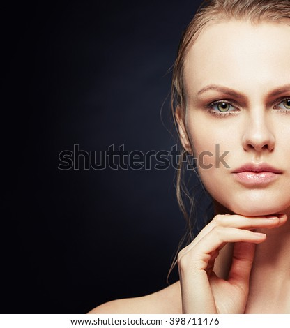 Portrait of beautiful caucasian blonde woman isolated on black background. Studio portrait. Toned - stock photo