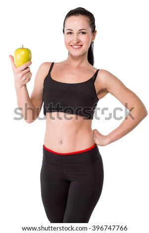 Portrait of beautiful caucasian sporty woman. Young athlete smiling, holding green apple and looking at camera. Isolated on white background - stock photo