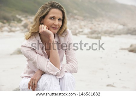 Portrait of beautiful Caucasian woman sitting at beach