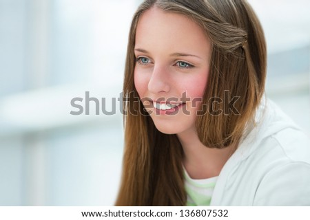 Portrait of beautiful caucasian young girl at campus. Copyspace - stock photo