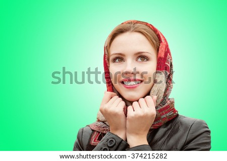 Portrait of beautiful charming smiling woman on a green background. - stock photo