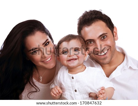 Portrait of beautiful cheerful family isolated on white background, mother and father hugging their cute daughter, happiness concept