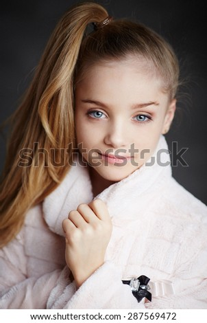 Portrait of beautiful child girl model with blue eyes. - stock photo