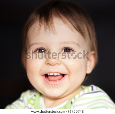 Portrait of beautiful child smiling - stock photo