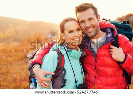 Portrait of beautiful couple hiking together during fall, autumn