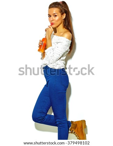 portrait of beautiful crazy smiling brunette woman girl in casual blue hipster summer clothes with no makeup isolated on white drinking soda from bottle with straw - stock photo