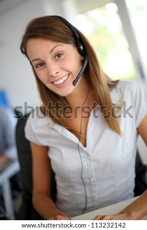 Portrait of beautiful customer service representative - stock photo