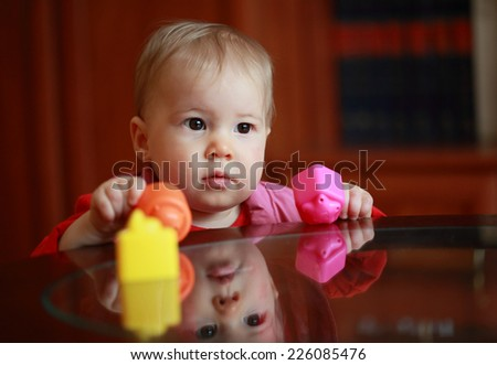 Portrait of beautiful cute child with toys - stock photo