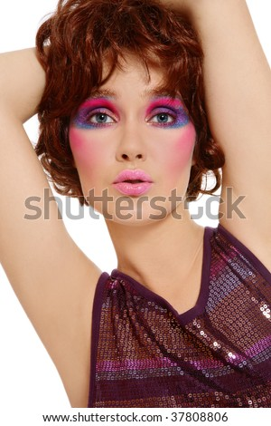Portrait of beautiful dancing girl in sparkly dress with crazy disco makeup - stock photo