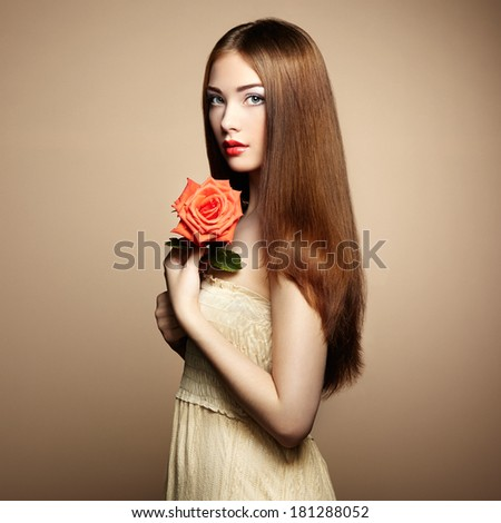 Portrait of beautiful dark-haired woman with flowers. Fashion photo - stock photo