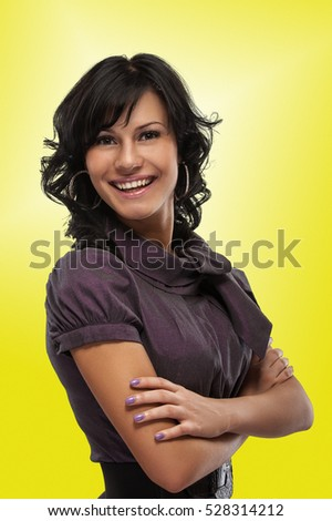Portrait of beautiful dark-haired young woman, on yellow background.