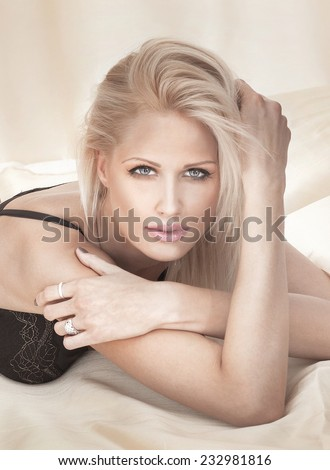 Portrait of beautiful delicate woman looking at camera.