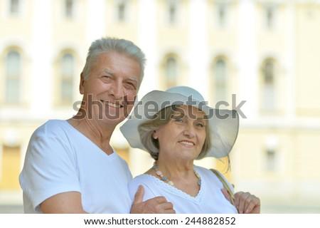 Portrait of beautiful elderly couple outdoor close-up - stock photo