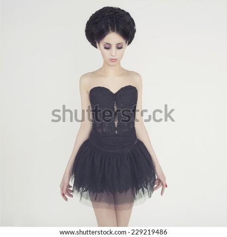 Portrait of beautiful elegant ballerina on white background - stock photo