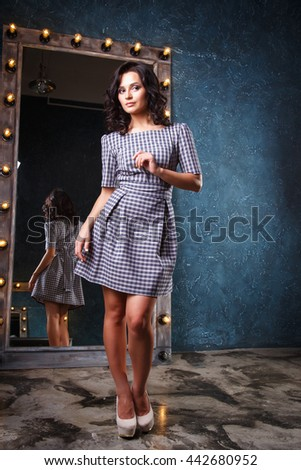 portrait of beautiful elegant young woman in gorgeous summer dress - stock photo