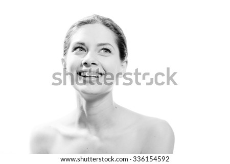 Portrait of beautiful exciting young woman with great dental care white teeth having fun happy smiling and looking up at white copy space background. Black and white photography - stock photo