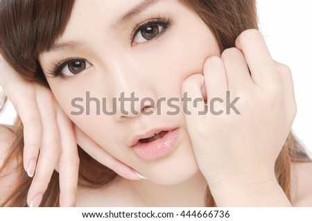 portrait of beautiful face of a young woman - stock photo