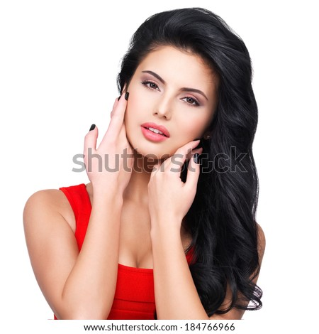 Portrait of beautiful face of an young woman with long brown hair in red dress - stock photo