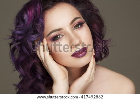 Portrait of beautiful fashion model with purple hair