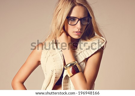 Portrait of beautiful fashion woman wearing glasses - stock photo