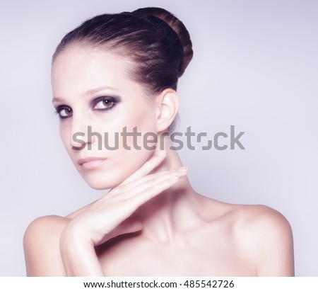 Portrait of beautiful fashionable woman with perfect healthy smooth skin isolated on white background.