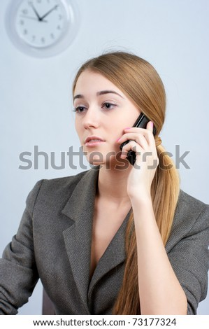 Portrait of beautiful female employee calling cellphone